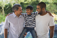 Happy multi-generation family standing at porch Royalty Free Stock Photos