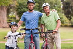 Happy multi generation family on their bike at the park Royalty Free Stock Photo