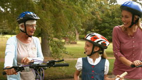 Happy multi generation family on their bike at the park stock video footage