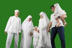 Happy multi-generation Indonesian muslim family in studio