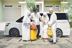 Happy multi-generation muslim family gathering together