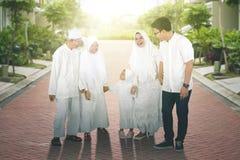 Happy multi-generation muslim family at park