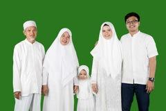 Multi-generation muslim family portrait in studio