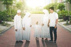 Happy multi-generation muslim family taking a walk