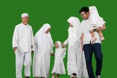 Happy multi-generation muslim family in studio