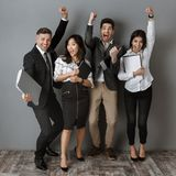 happy multicultural business people with folders and notebooks standing royalty free stock images