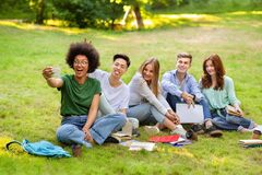 Happy Multicultural College Students Having Fun While Taking Group Selfie Outdoors