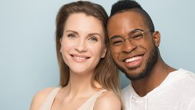 Happy multicultural couple posing for portrait in studio royalty free stock photo