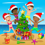 Happy Multicultural Kids swimsuit xmas hat jumping tree tropical beach royalty free illustration