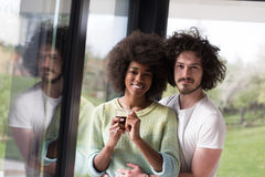 Happy multiethnic couple relaxing at modern home indoors Stock Photo