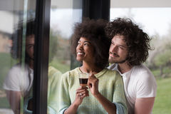 Happy multiethnic couple relaxing at modern home indoors Royalty Free Stock Images