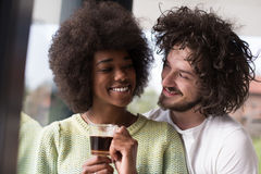 Happy multiethnic couple relaxing at modern home indoors Royalty Free Stock Photo