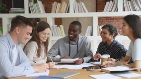 Happy multiethnic diverse college university students team study together