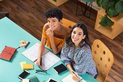 Happy multiethnic girl studying together royalty free stock photography