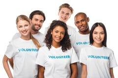 Multiethnic group of volunteers. Happy multiethnic group of volunteers isolated on white royalty free stock photography
