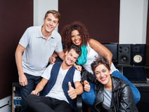 Happy Multiethnic Musicians In Recording Studio Royalty Free Stock Photo