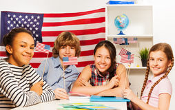 Happy multiethnic students at the geography lesson Royalty Free Stock Images