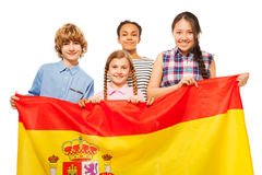 Happy multiethnic teenage kids with flag of Spain Royalty Free Stock Image