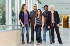 Happy Multiethnic University Students At Corridor Stock Photos