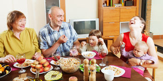 Happy multigeneration family  around festive table Royalty Free Stock Photography