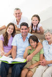 Happy multigeneration family with book Royalty Free Stock Image