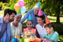 Happy multigeneration family celebrating birthday party royalty free stock photography