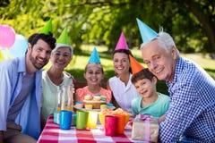 Happy multigeneration family celebrating birthday party in park royalty free stock photography
