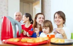 Happy multigeneration family communicate over tea Stock Images