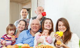 Happy multigeneration family communicate over tea. At home Stock Photo