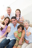 Happy multigeneration family gesturing thumbs up Royalty Free Stock Photos