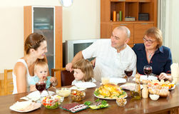 Happy multigeneration family having holiday dinner. At home together Royalty Free Stock Images