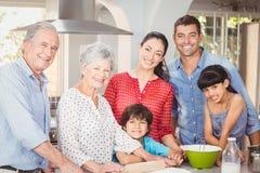 Happy multigeneration family in kitchen royalty free stock photos