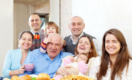 Happy multigeneration family. Portrait of happy multigeneration family communicate over tea at home Royalty Free Stock Images