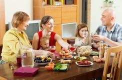 Happy multigeneration family posing  over celebratory table Royalty Free Stock Images
