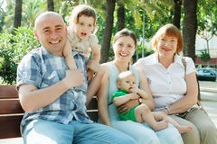 Happy multigeneration family   in sunny summer day Royalty Free Stock Image
