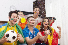 Happy multinational soccer fans Royalty Free Stock Photo
