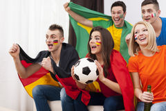 Happy multinational soccer fans Stock Photos