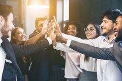 Free Happy Multiracial Business Team Giving High Fives Royalty Free Stock Photography - 135909177