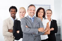Happy multiracial businesspeople. Group Of Happy Multiracial Businesspeople Standing In A Row stock photography