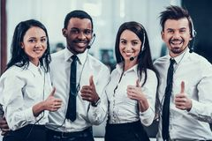 Happy multiracial call center team shows thumbs up. Multicultural team.Work at office royalty free stock photos