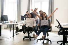 Happy multiracial colleagues group having fun together in office stock image