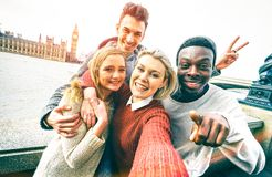 Happy multiracial friends group taking selfie in London city royalty free stock photo