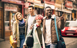 Happy multiracial friends walking on Brick Lane at Shoreditch Royalty Free Stock Image