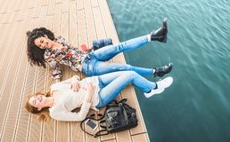 Happy multiracial girlfriends having genuine fun at jetty pier d. Ocks - Friendship concept with girls at spring break travel - Modern lifestyle with female best royalty free stock photography