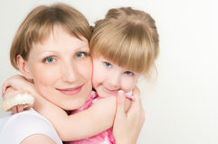 Happy mum with the babe Stock Images