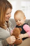 Happy mum and baby with teddy bear Stock Photos