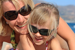 Happy mum with a daughter. Have a rest on the sea Royalty Free Stock Photo