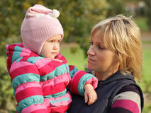 Happy mum with a daughter in autumn park Stock Image