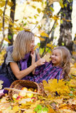 Happy mum and the daughter play autumn park Royalty Free Stock Photos