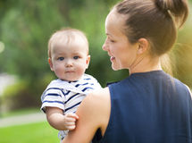 Happy mum and her child playing in park together Stock Photography